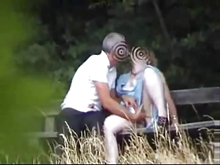 lady inside the garden having pleasure with man