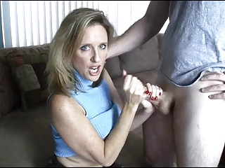 woman gives handjob toyoung guy