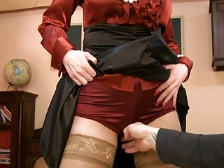 woman into glasses and satin nylons takes slutty