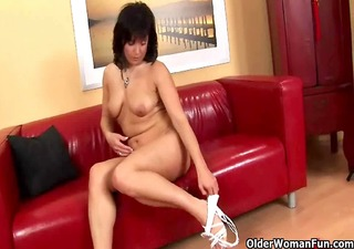 mature mom plays with her swollen love tunnel